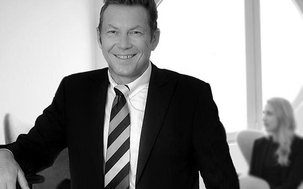 Robert Trögele, Managing Partner und Berater bei AXXCON